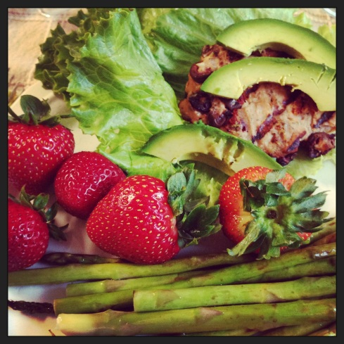 Clean eats at their best! Mediterranean turkey burger, asparagus, and strawberries.